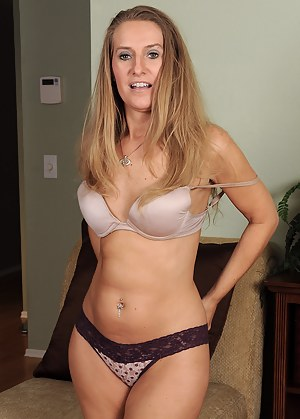 Hot blonde housewife Sara J strips and pinches her perky nipples
