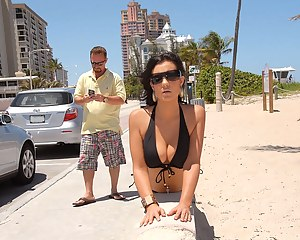 Lustful lady is taking off her black bikini sunbathing on the beach. She is also feeling great getting her wet holes penetrated with long cock.