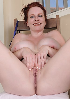 40 year old Red Vixen lets loose her mammoth juggs in the hallway