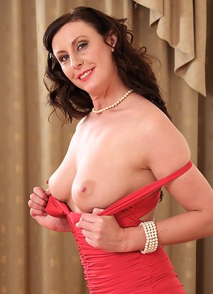 37 year old Lara Latex slips out of her red elegant dress to spread