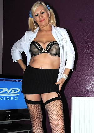 Platinum Blonde as a naughty school girl with pigtails.