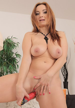 38 year old redheaded Jessica Red stuffing her beaver with her toy