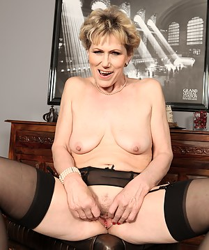 Elegant 57 year old Georgina C uses her glasses to toy her pussy