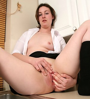 Beth gets naked to spread and play with her shaven pussy