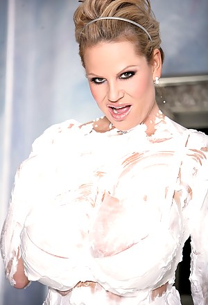 Kelly show off her boobs in different outfits and ends with a sexy shaving cream mess.