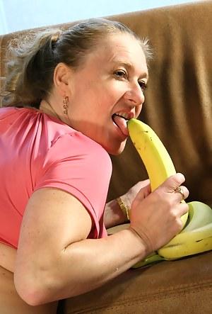 Naughty housewife playing with a banana