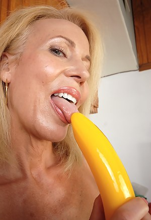 Furry housewife Erica dips a plastic banana in her 54 year old box