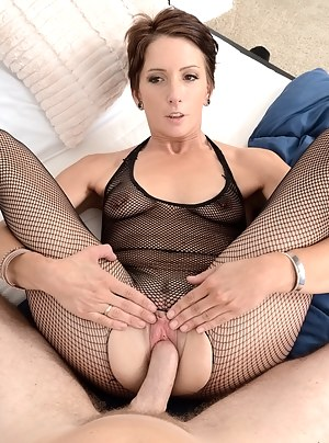 Amazingly sweet woman wearing sexy black stockings is torturing her lover's cock with her hands, feet and tongue. She is also getting her vagina banged.