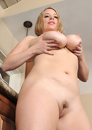 Horny 35 year old Maggie G from AllOver30 strips naked in the kitchen