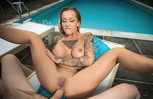 Tatted-up and trashy-looking babe makes her intentions clear: she wants that cock, she wants it now and she wants it inside of her tight twat.