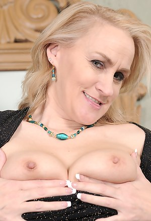 46 year old Emerald Rose from AllOver30 slips out of her black dress