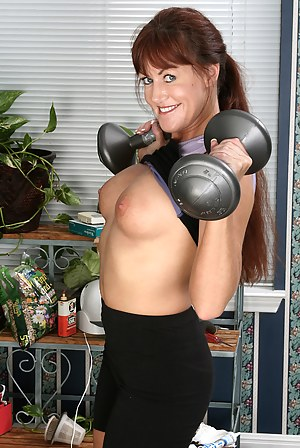 Athletic and mature redhead Shauna from AllOver30 working out naked