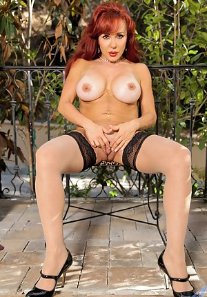 Horny milf Vanessa Bella satisfies her mature pussy with a sex toy outside