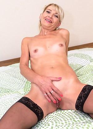 Older amateur Joanne Darby naked in her black stockings.