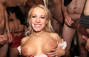 Tara Spades might be a new model but she sure knows her way round a bunch of cocks- check out this amazing model as she sucks dick and takes some amazing facials.
