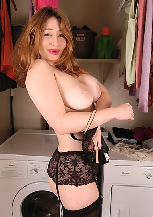 Natural busty redheaded MILF poses in and out of lingerie
