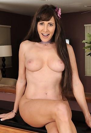 Elegant 47 year old Alexandra Silk spreading her long firm legs