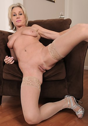 Hot elegant 53 year old blonde Payton Hall spreading wide on the chair