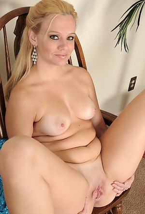 Elegant blonde Lily Sway strips and spreads her 30 year old legs