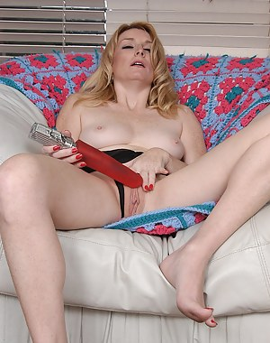 Sweet Ashley rides a gigantic red toy for the camera