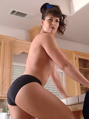 Tight bodied Andy having fun being naked in the kitchen