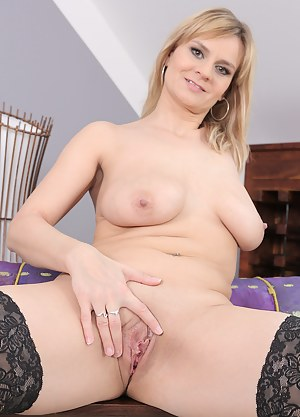 37 year old Charlotta Rose opens her stocking covered legs wide