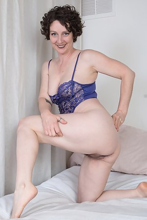 42 year old Artemesia from AllOver30 toying her mature furry pussy