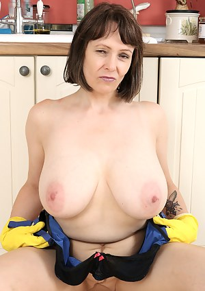 Busty curvy Tigger in the kitchen