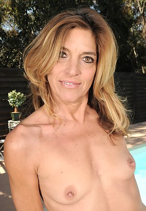51 year old Monique gets naked and spread outdoors at the pool
