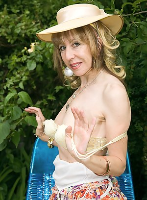Sexy and petite Lizzy shows off her hairy pussy out in her garden