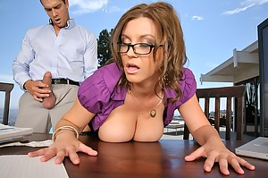 MILF redhead takes part in a tremendous fuck session with a handsome stud, who loves teasing big tits and have his cock between them.