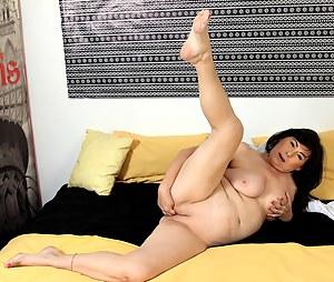 Busty mature amateur Kata fingers her older pussy.