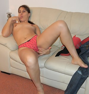 Naughty mom playing on the couch with her pussy