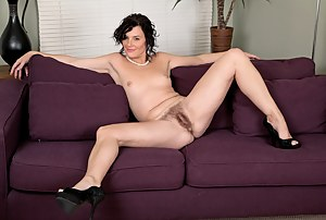Lounging around in her lingerie, Sofia Mathews can't seem to get comfortable on the couch. She moves around and slowly strips. Naked and playing with her hairy pussy, Sofia is finally comfortable!