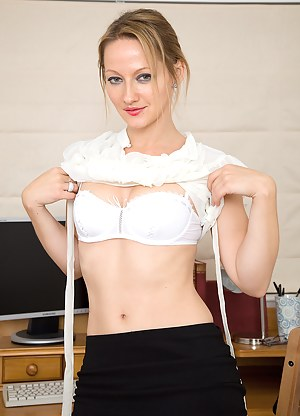 Office MILF Tara Trinity takes a break from her work to probe pussy