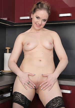Blonde 33 year old Niky DeVine showing off her sexy black stockings
