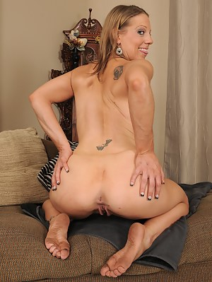 Petite and mature Alyssa Dutch in pink ligerie opens up her hot box
