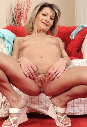 Petite and horny housewife Syndi Bell strips and spreads her ass wide