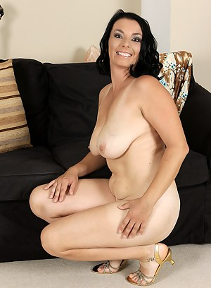 Brunette 35 year old Leona Sweet from AllOver30 opens her legs wide