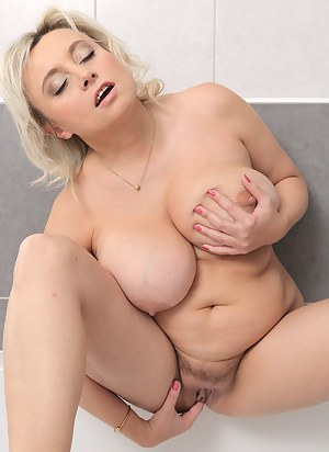 Blonde and busty 44 year old Sindy Huga getting off in the bathtub
