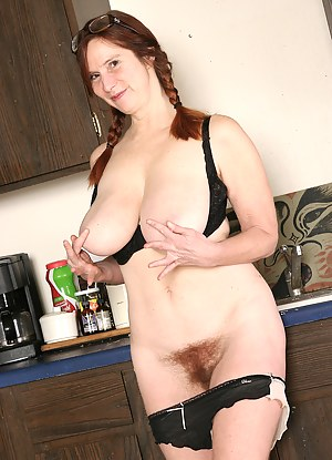 Big and busty redhead Breeze from AllOver30 shows off her hairy box