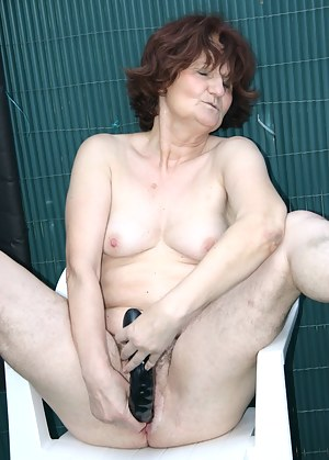 Granny fucked by a younger man in her own garden