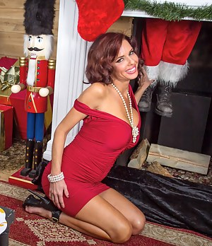 It's Christmas Eve and this short-haired redhead MILF is all alone, she wants some younger stud to plow her pussy and gets what she wants in the end.