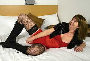 Naughty housewife playing with her rubber friend