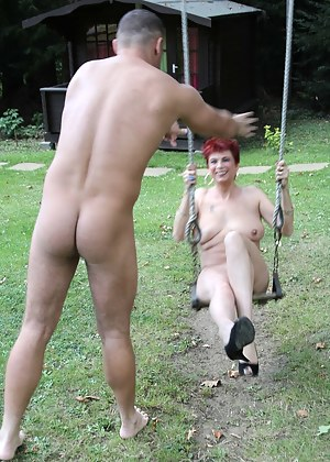 Photos of me having a naked swing while two horny men push me.