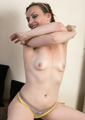 Elegant MILF Amber K from AllOver30 pulls at her 33 year old pussy