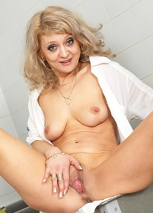 Blonde mature slut doing her laundry