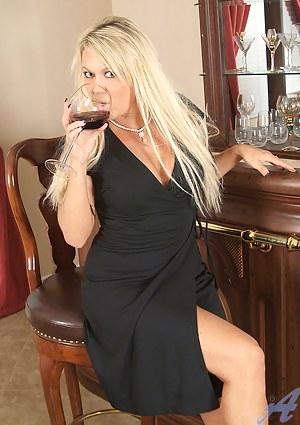 Lustful blonde Anilos exposes her beautiful pink milf clitoris
