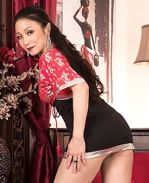Mature Asian babe Aya May rubbing her clit.