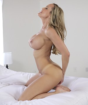 Beautiful blonde mom with giant tits spreads open her sweet trimmed pussy